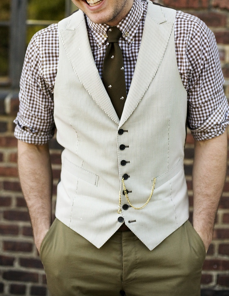 A delightfully dandy combination of checks, a waistcoat and a watch chain.