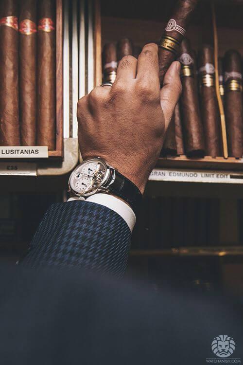 gentleman watch at wrist with cigar