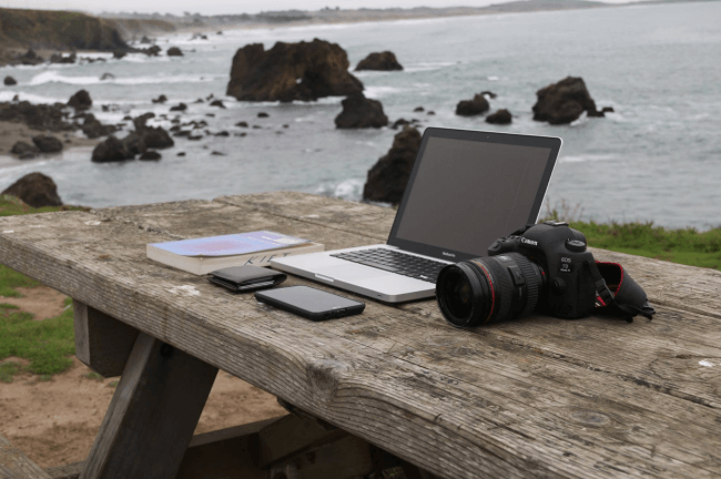 working outdoors with a sea view